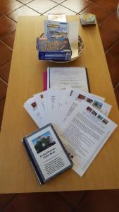 Welcome-pack-and-handbooks-169x300 Around the World