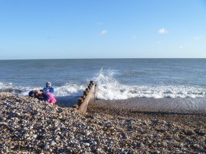 Waves-and-family-by-groyne-300x225 Why countryside holidays are good for the Soul.